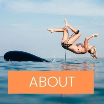 Woman falling off surfboard